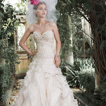 "Opal organza is artfully draped to create this luxurious ball gown wedding dress, featuring a decadent dropped bodice, encrusted with stunning Swarovski crystals, pearls and sequins. Finished with sweetheart neckline and crystal buttons over zipper and inner corset closure.  <a href=""http://www.maggiesottero.com/dress.aspx?style=5MT651"" target=""_blank"">Maggie Sottero</a>"