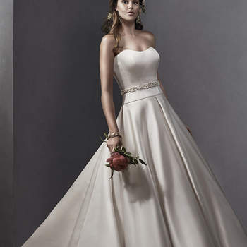 """Dramatic Delustered satin drapes the bodice of this traditional ballgown, full skirt with inverted pleats and pockets. Complete with subtle scoop neckline and optional sparkling Swarovski crystal belt. Finished with zipper over inner corset closure. Available with optional beaded embroidered lace jacket with dazzling Swarovski crystals.  <a href=""""http://www.sotteroandmidgley.com/dress.aspx?style=5SS099"""" target=""""_blank"""">Sottero and Midgley Spring 2015</a>"""