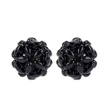 Pendientes de flores de Simone Rocha (119 euros)