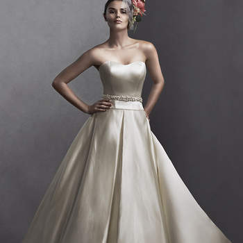 """Sister style to our Taiya (5SS099), romantic silk drapes the bodice of this ballgown skirt with pleats and pockets. Complete with subtle scoop neckline and optional Swarovski crystal belt. Finished with zipper over inner corset closure. Available with optional jacket featuring Swarovski crystals.  <a href=""""http://www.sotteroandmidgley.com/dress.aspx?style=5SS098"""" target=""""_blank"""">Sottero and Midgley Spring 2015</a>"""