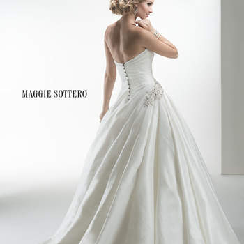 "Decadent Lovelle taffeta ballgown, complete with asymmetrical draping, Swarovski crystal embellishment at the hip, and dramatic voluminous skirt, finished with sweetheart neckline and crystal button over zipper and inner corset closure.  <a href=""http://www.maggiesottero.com/dress.aspx?style=4MD013"" target=""_blank"">Maggie Sottero Platinum 2015</a>"