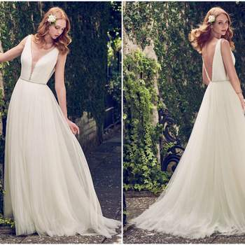 "This Grecian-inspired A-line features voluminous layers of tulle with bead and Swarovski crystal trim along the illusion plunging neckline, illusion side panels, waist, straps, and V-back. Finished with zipper closure.  <a href=""https://www.maggiesottero.com/maggie-sottero/tamar/11194?utm_source=zankyou&amp;utm_medium=gowngallery"" target=""_blank"">Maggie Sottero</a>"