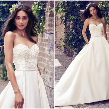 """This Elodie Mikado wedding dress features a bodice accented in beaded lace motifs atop a pleated ballgown skirt with pockets. Complete with bead and Swarovski crystal belt and strapless sweetheart neckline. Finished with covered buttons over zipper closure.   <a href=""""https://www.maggiesottero.com/maggie-sottero/giselle/11171?utm_source=zankyou&amp;utm_medium=gowngallery"""" target=""""_blank"""">Maggie Sottero</a>"""