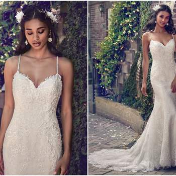 """This wedding dress features embroidered lace motifs along the sweetheart neckline, illusion scoop back, and bodice, flowing into an allover lace bodice and skirt. Delicate beaded spaghetti straps complete the chic romance of this sheath gown. Finished with crystal buttons over zipper closure.   <a href=""""https://www.maggiesottero.com/maggie-sottero/teresa/11195?utm_source=zankyou&amp;utm_medium=gowngallery"""" target=""""_blank"""">Maggie Sottero</a>"""