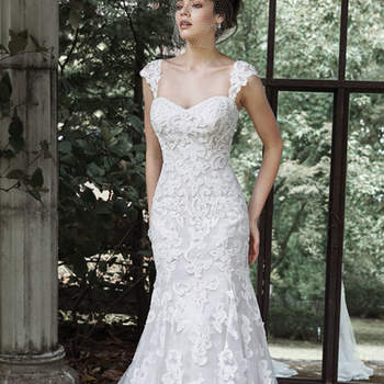 "Bold patterns of dramatic lace are featured in this romantic wedding dress, with a form-fitting bodice and subtle flared skirt. Lace cap-sleeves and a romantic light-as-air tulle veil are offered separately. Finished with corset closure.  <a href=""http://www.maggiesottero.com/dress.aspx?style=5MN696"" target=""_blank"">Maggie Sottero</a>"
