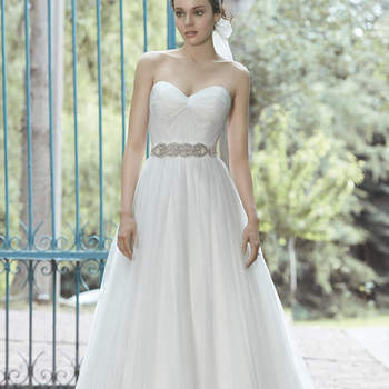 "Femininity is found in this tulle ballgown, complete with ruching at the bodice and detachable grosgrain belt. A Swarovski crystal belt is also available for a dazzling touch. Finished with romantic sweetheart neckline and covered button over zipper and inner corset closure.  <a href=""http://www.maggiesottero.com/dress.aspx?style=5MS029"" target=""_blank"">Maggie Sottero Spring 2015</a>"