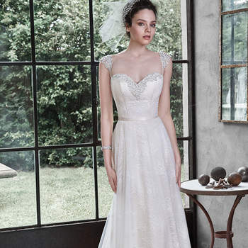 """<a href=""""http://www.maggiesottero.com/dress.aspx?style=5MT674"""" target=""""_blank"""">Maggie Sottero</a>"""