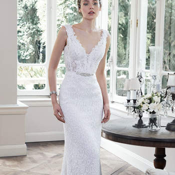 "Subtle elegance is found in this classic lace sheath wedding dress, with demure illusion lace adorning the bodice. A scalloped V-neck, daring open back, and unembellished grosgrain ribbon belt accent the dress. Grosgrain ribbon belt accented with Swarovski crystal motif offered separately. Finished with covered buttons over zipper closure.   <a href=""http://www.maggiesottero.com/dress.aspx?style=5MN690"" target=""_blank"">Maggie Sottero</a>"
