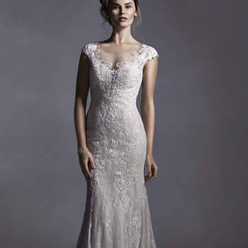 "Glamorous, glimmering lace appliqués adorn tulle in this sheath dress with illusion neckline and plunging illusion back. Complete dainty  lace cap-sleeves. Finished with covered button over zipper closure.  <a href=""http://www.sotteroandmidgley.com/dress.aspx?style=5SS025"" target=""_blank"">Sottero and Midgley Spring 2015</a>"