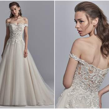 "Beaded lace motifs and Swarovski crystals dance over the bodice of this off-the-shoulder wedding dress, completing the illusion sweetheart neckline and illusion open back. Ballgown skirt comprised of tulle. Finished with crystal buttons and zipper closure.  <a href=""https://www.maggiesottero.com/sottero-and-midgley/safira/11228?utm_source=zankyou&amp;utm_medium=gowngallery"" target=""_blank"">Sottero and Midgley</a>"