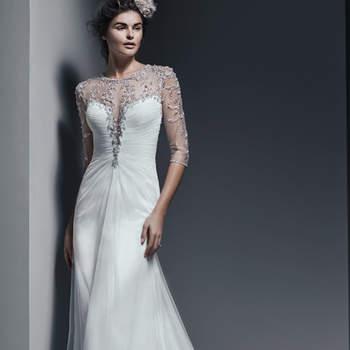 """L'élégance en toute simplicité. Cette robe de mariée fourreau est fluide et disponible à Paris en mousseline ou tulle. On aime le décolleté sage illusion et  les pièces scintillantes en cristaux de Swarovski. Les manches sont trois-quarts.   <a href=""""http://www.sotteroandmidgley.com/dress.aspx?style=5SR684MC"""" target=""""_blank"""">Sottero &amp; Midgley</a>"""