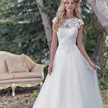 """A stunning illusion lace neckline takes center stage in this ball gown wedding dress, with enchanting lace bodice and flowing tulle skirt. A breathtaking illusion lace keyhole back adds a dose of drama. Finished with dainty cap-sleeves and zipper closure. <a href=""""www.maggiesottero.com/maggie-sottero/chandler/9490"""" target=""""_blank"""">Maggie Sottero</a>"""