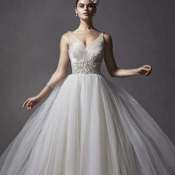 """Tulle creates this romantic ballgown, complete with lavish beaded, plunging illusion neckline and soft, voluminous skirt. Finished with invisible zipper closure.  <a href=""""http://www.sotteroandmidgley.com/dress.aspx?style=5SR038"""" target=""""_blank"""">Sottero and Midgley Spring 2015</a>"""