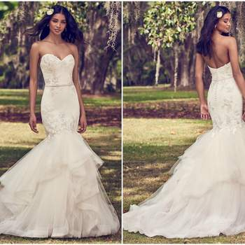 """This mermaid wedding dress features a tulle bodice accented in embroidered lace motifs atop a tiered tulle fit-and-flare skirt edged in horsehair. Complete with strapless sweetheart neckline and bead and pearl embellished belt. Lined with shapewear for a figure-flattering fit. Finished with covered buttons over zipper closure.   <a href=""""https://www.maggiesottero.com/maggie-sottero/dalinda/11166?utm_source=zankyou&amp;utm_medium=gowngallery"""" target=""""_blank"""">Maggie Sottero</a>"""