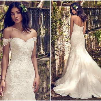 """This fit-and-flare wedding dress features beaded lace motifs atop tulle, complete with strapless sweetheart neckline and breathtaking lace hemline. Finished with covered buttons over zipper closure and inner corset. Detachable Cap Sleeves accented in beading and Swarovski crystals sold separately.    <a href=""""https://www.maggiesottero.com/maggie-sottero/saige/11192?utm_source=zankyou&amp;utm_medium=gowngallery"""" target=""""_blank"""">Maggie Sottero</a>"""