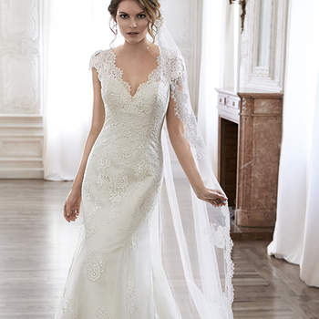 "Completely timeless is this A-Line wedding dress. Constructed of delicate lace and ethereal tulle, this gown features scalloped trim adorning the V-neckline and plunging back. Complete with dainty lace sleeves and finished with covered button over zipper back closure. Available with veil.  <a href=""http://www.maggiesottero.com/dress.aspx?style=5MS019"" target=""_blank"">Maggie Sottero Spring 2015</a>"
