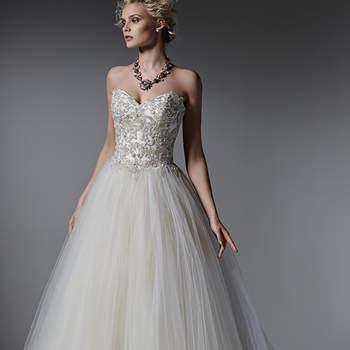 """Camadas caprichosas de tule criam a saia deste vestido de noiva romântico, enquanto cristais Swarovski, pérolas e contas decoram o corpete. Acabamento com decote coração e fechamento espartilho. <a href=""""https://www.maggiesottero.com/sottero-and-midgley/layla/9585"""" target=""""_blank"""">Sottero and Midgley</a>"""