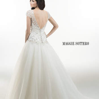 "Timeless Chic organza ballgown with dazzling heavily beaded embroidered bodice, accented with stunning Swarovski crystals. Finished with plunging V-back, adorned with crystal buttons and zipper over inner elastic back closure.  <a href=""http://www.maggiesottero.com/dress.aspx?style=4MT921"" target=""_blank"">Maggie Sottero Platinum 2015</a>"