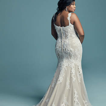 """<a href=""""https://www.maggiesottero.com/maggie-sottero/abbie-lynette/11451"""">Maggie Sottero</a>  This elegant fit-and-flare wedding dress offers additional coverage to our Abbie style, featuring embroidered lace motifs and crosshatching dance over tulle. Chic lace straps glide from the illusion plunging sweetheart neckline to the scoop back, all accented in beaded lace motifs. Lined with shapewear for a figure-flattering fit. Finished with covered buttons over zipper closure."""