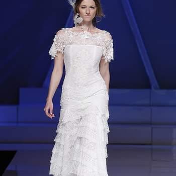 Dentelle, volants et manches courtes : un modèle ultra féminin. Photo : Barcelona Bridal Week