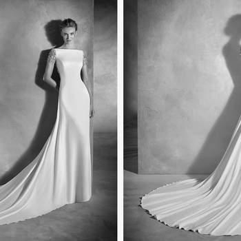 Brautkleid mit Boot-Ausschnitt und schmeichelnder Meerjungfrauen-Silhouette, die weibliche Kurven zaubert. Ein Modell aus Crepe mit einem schönen Mosaik aus Edelsteinen auf Ärmeln und Rücken.