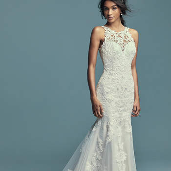 """<a href=""""https://www.maggiesottero.com/maggie-sottero/kendall/11488"""">Maggie Sottero</a>  Classic yet striking, this fit-and-flare wedding dress features beaded lace motifs, crosshatch details, and Swarovski crystals over tulle. Lace motifs adorn the illusion halter over sweetheart neckline and illusion back. An illusion double-lace train completed the elegant romance of this look. Finished with covered buttons over zipper closure."""