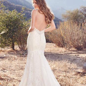 Mit diesem Brautkleid werden Sie am Traualtar für Wow-Momente sorgen, denn Ihr Rücken liegt frei....