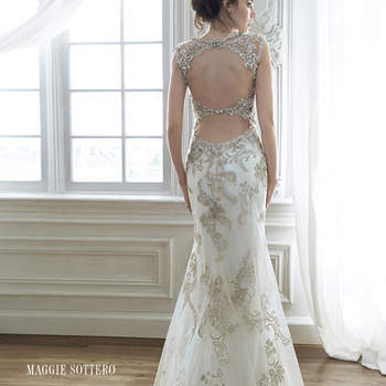 "Exquisite bead embroidered lace adorns the bodice in this sheath wedding dress with Swarovski crystal neckline. Complete with stunning double keyhole back. Finished with zipper closure. <a href=""http://www.maggiesottero.com/dress.aspx?style=5MD056&amp;page=0&amp;pageSize=36&amp;keywordText=&amp;keywordType=All"" target=""_blank"">Maggie Sottero</a>"