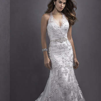 "Floral lace appliqués adorn delicate tulle in this romantic sheath dress, complete with plunging halter neckline and sparkling Swarovski crystal belt at the waist. Finished with blouson back and covered button over zipper closure.  <a href=""http://www.sotteroandmidgley.com/dress.aspx?style=5SW139"" target=""_blank"">Sottero and Midgley Spring 2015</a>"