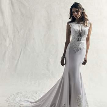 Los adornos de encaje bailan sobre el corpiño de este vestido de novia de corte ceñido.