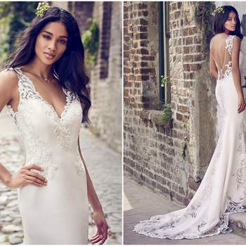 """Embroidered lace motifs adorn the illusion cutout train, illusion scoop back, illusion straps, and illusion V-neckline in this Aldora Crepe sheath wedding dress. Finished with crystal buttons over zipper closure.   <a href=""""https://www.maggiesottero.com/maggie-sottero/veronica/11198?utm_source=zankyou&amp;utm_medium=gowngallery"""" target=""""_blank"""">Maggie Sottero</a>"""
