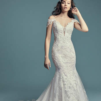 """<a href=""""https://www.maggiesottero.com/maggie-sottero/della/11465"""">Maggie Sottero</a>  Beaded lace motifs and Swarovski crystals cascade over tulle in this fit-and-flare wedding dress, featuring an illusion double-lace train. Beaded spaghetti straps complete the illusion plunging sweetheart neckline and illusion scoop back, both accented in lace motifs. Attached cold-shoulder sleves accented in lace motifs can be removed easily to fit a bride's preference. Finished with covered buttons over zipper closure."""