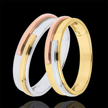 Un par de elegantes alianzas tricolor con oro blanco y oro amarillo de 9 quilates. Un ejemplo de originalidad y elegancia en tus alianzas de boda. Foto: Edenly.  http://tinyurl.com/c3tzuya
