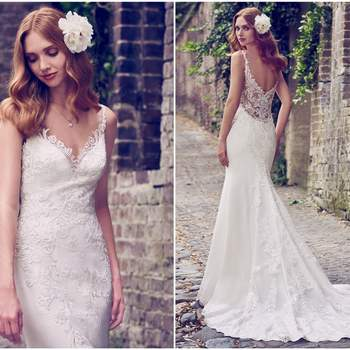 """Embroidered lace motifs cascade over tulle and Donella Crepe in this sheath wedding dress, accenting the illusion sweetheart neckline, illusion straps, and illusion scoop back. Lined with Inessa Jersey for a luxe fit. Finished with crystal buttons and zipper closure.  <a href=""""https://www.maggiesottero.com/maggie-sottero/kiandra/11175?utm_source=zankyou&amp;utm_medium=gowngallery"""" target=""""_blank"""">Maggie Sottero</a>"""