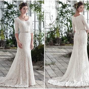 "Feminine yet simply elegant, this unembellished lace fit and flare wedding dress over Inessa jersey, with three-quarter sleeves and scoop neckline, puts emphasis on refined lightness. Finished with covered buttons over zipper closure. Detachable beaded belt sold separately.   <a href=""https://www.maggiesottero.com/maggie-sottero/fairchild/9774"" target=""_blank"">Maggie Sottero</a>"