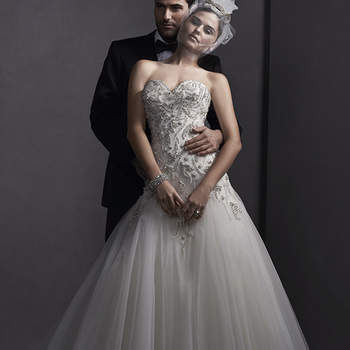 """Glamorous Swarovski crystal beads adorn this fit and flare wedding dress with tulle skirt. Complete with a romantic sweetheart neckline. Finished with crystal button over zipper and inner corset closure.   <a href=""""http://www.sotteroandmidgley.com/dress.aspx?style=5SW144"""" target=""""_blank"""">Sottero and Midgley Spring 2015</a>"""