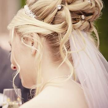 Pinned curls with beading and veil