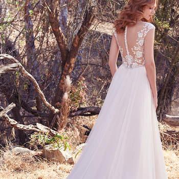 Dieses Brautkleid hat ein weiteres Highlight im Rückenbereich versteckt: hier offenbaren sich sexy Einblicke auf den Rücken mit einem zarten Illusions-Stoff.