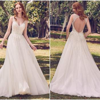 """This vintage-inspired wedding dress features swirls of beading and Swarovski crystals atop tulle in an A-line silhouette. Illusion straps glide from V-neckline to keyhole back accented in crystals. Finished with covered buttons and zipper closure.  <a href=""""https://www.maggiesottero.com/maggie-sottero/jace/11174?utm_source=zankyou&amp;utm_medium=gowngallery"""" target=""""_blank"""">Maggie Sottero</a>"""