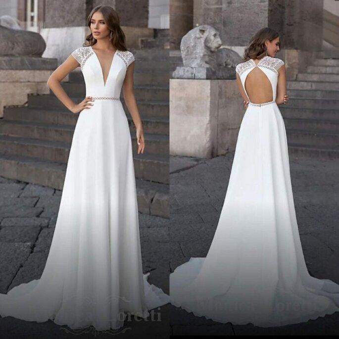 Robe de mariée longue à petites manches à retrouver chez Wedding Concept.