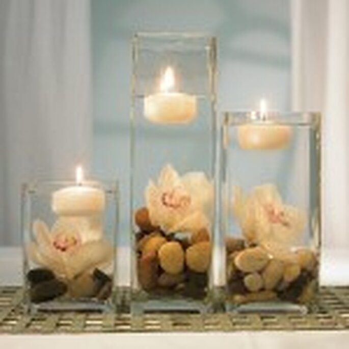 Table centrepiece with water, flowers and floating candles