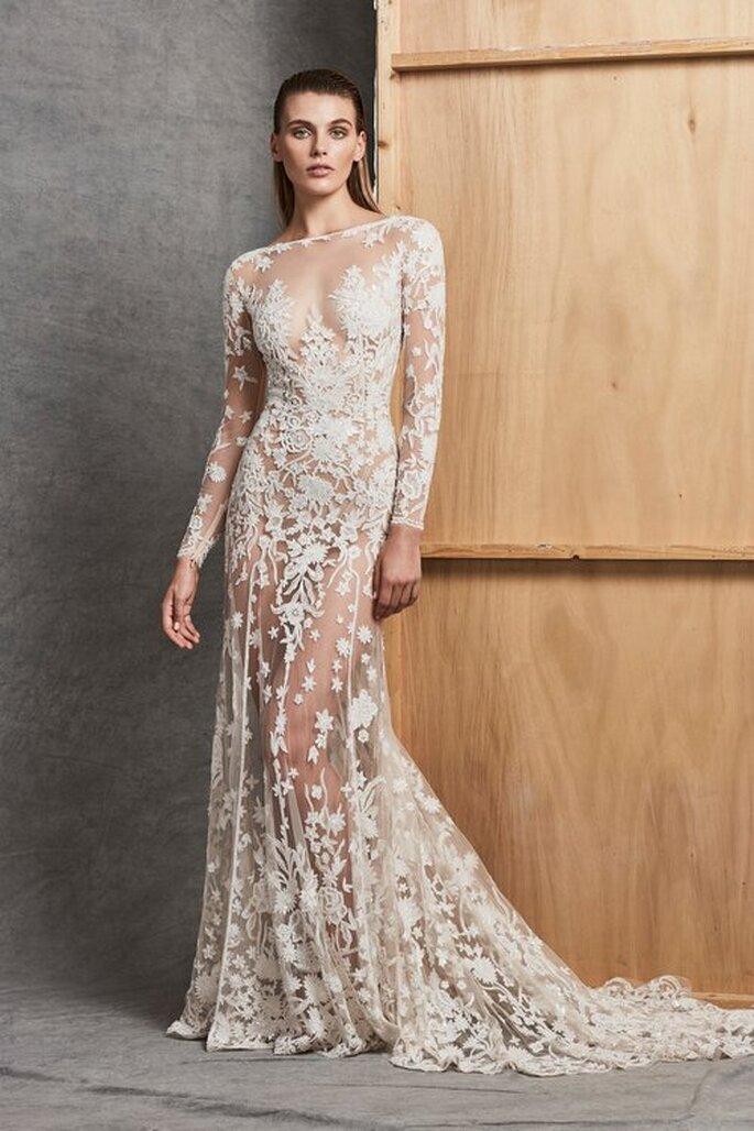 Vestidode noiva em renda com manga longa e leve transparência