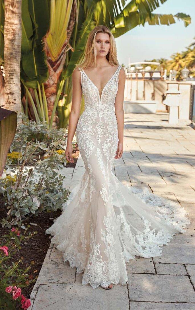 Déclaration Mariage - un modèle posant dans une robe de mariée sirène sans manche