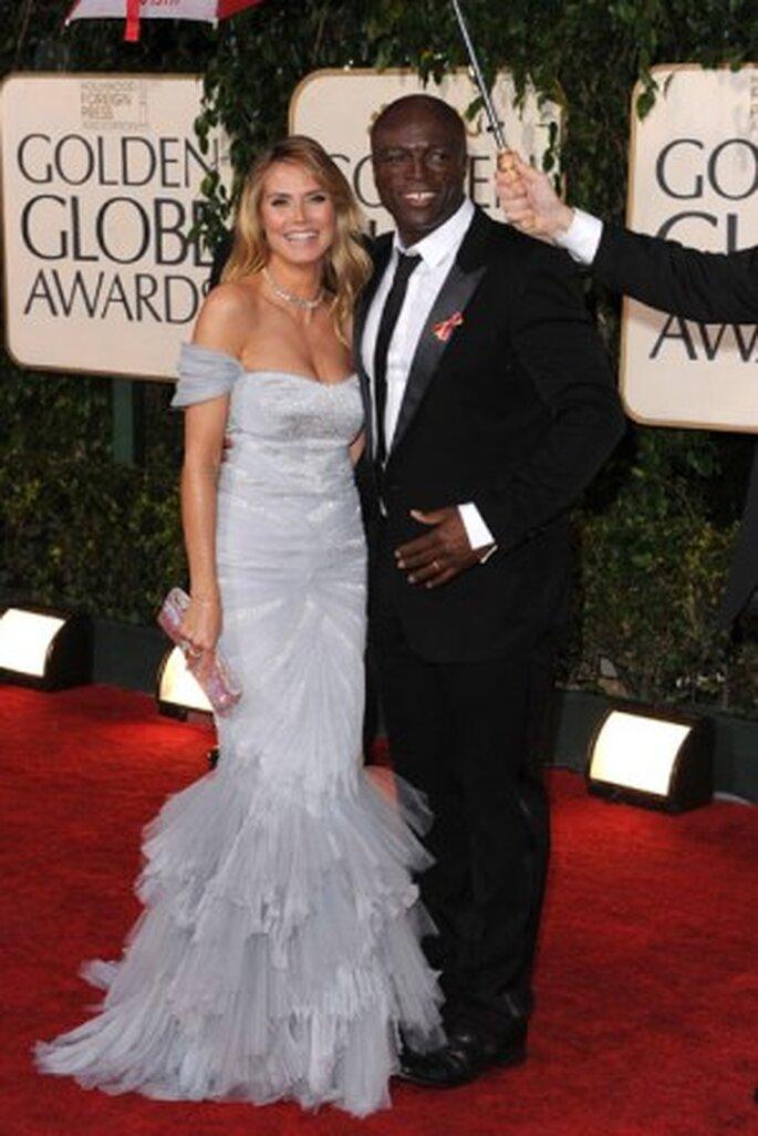 Heidi Klum, com o seu marido Seal, com um modelo de Roberto Cavalli