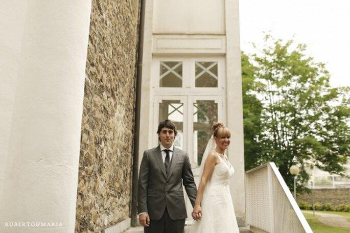 Recien casados sonrientes frente a la camara - Foto Roberto & Maria
