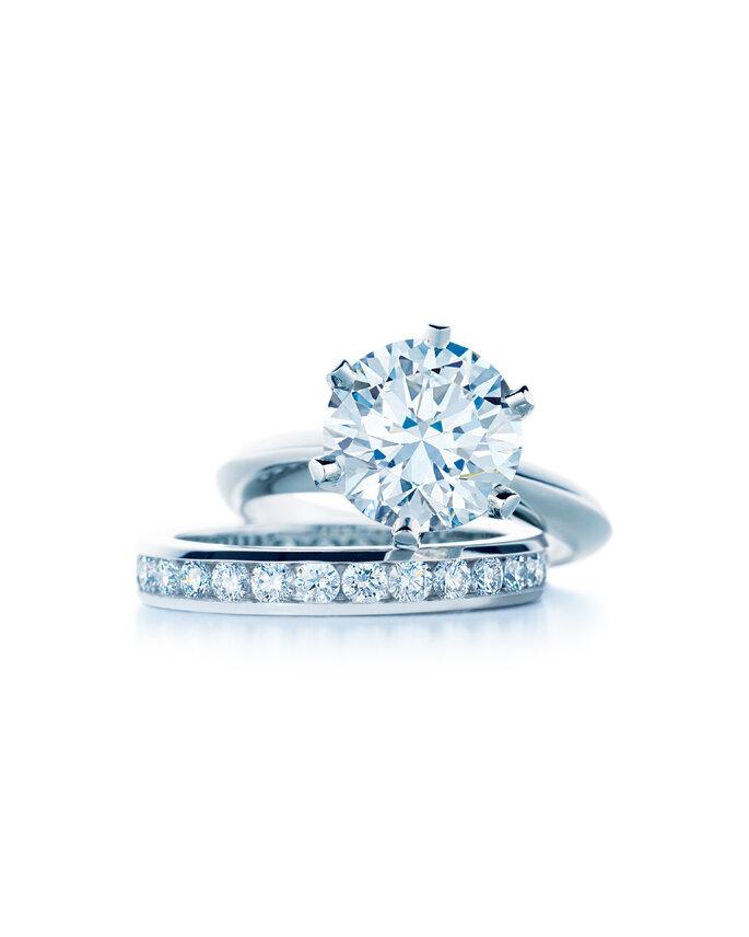Tiffany® Setting diamond engagement ring and diamond band in platinum