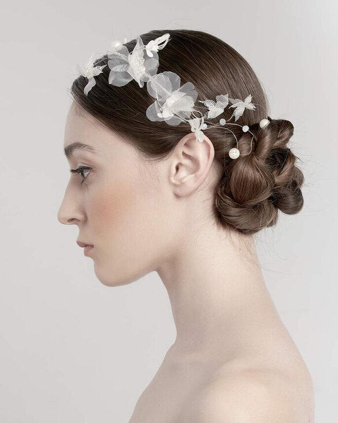 Un superbe chignon tressé très sophistiqué - une coiffure de mariage originale
