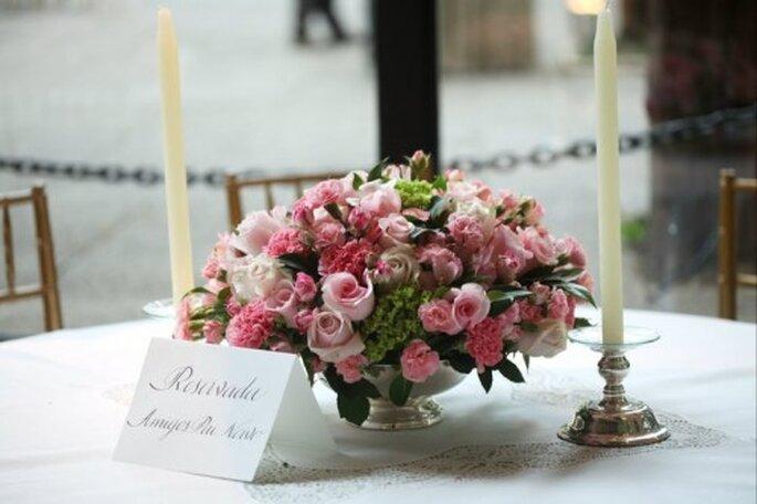 Centros de mesa con flores rosas. Foto de Boutique de 3