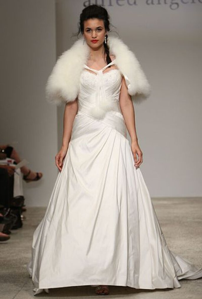 These winter wedding dresses have long sleeves warm boleros and shimmering