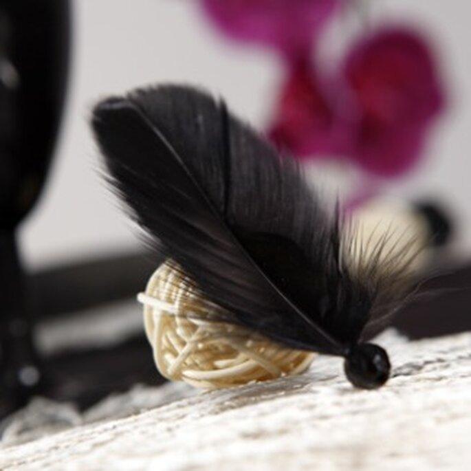 Décoration de table originale grâce à ces plumes avec perle